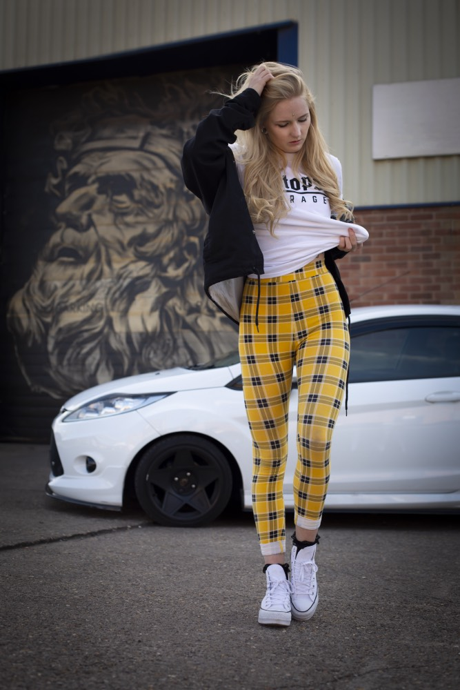 Woman with car in background