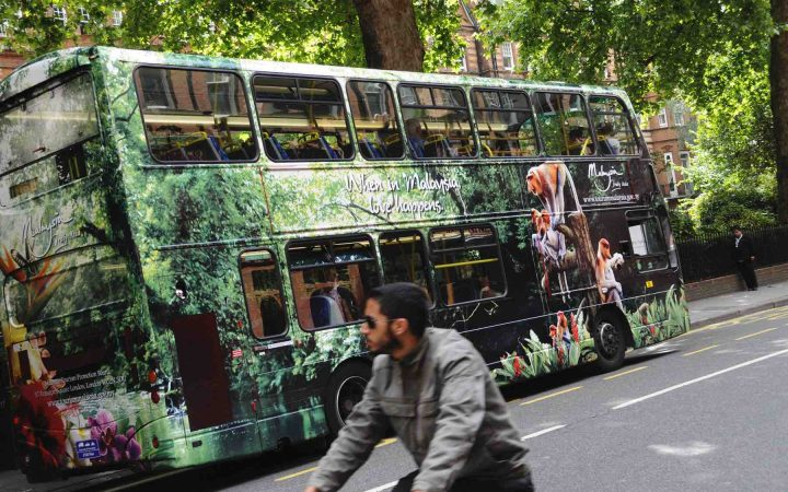A bus advertising Truly Asia passes through central London