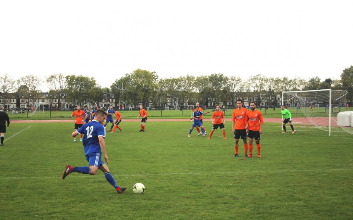 Mike Sholly takes a free kick against the opposition into a crowded penalty box