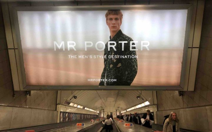 Advert for Mr. Porter on the underground above an escalator