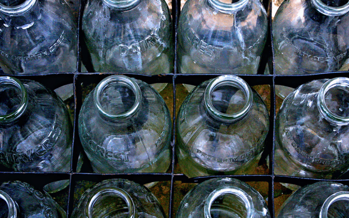 Close up of a crate of dairy crest glass milk bottles