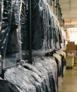 Suits hanging in a stock room