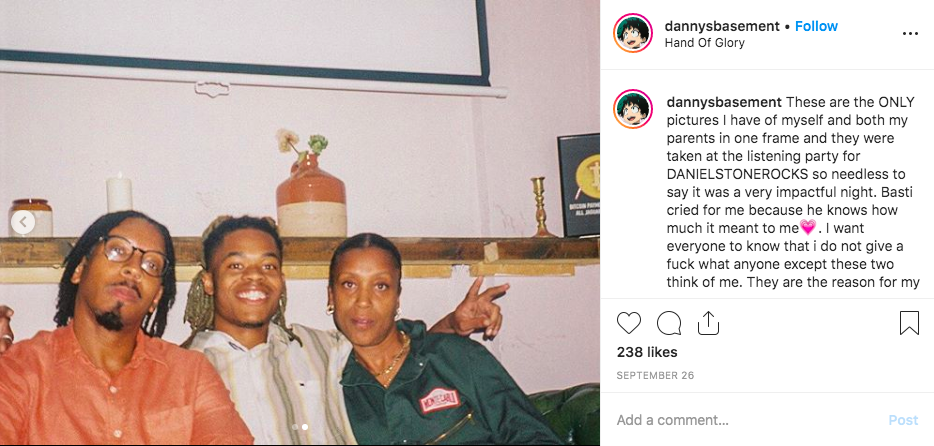 Screenshot of an Instagram photo where alternative hip hop artist Danny Trash sits on a couch together with his parents.
