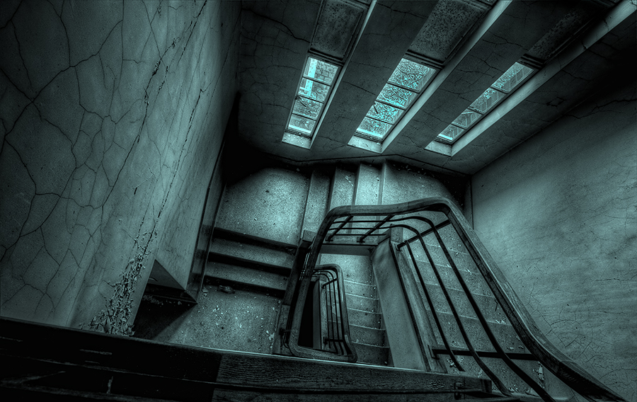 A dilapidated staircase from above. This is an abandoned asylum.