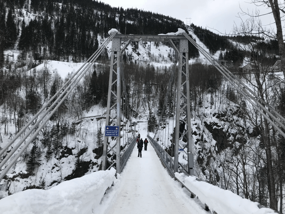 A long bridge leading into Vemork covered in snow