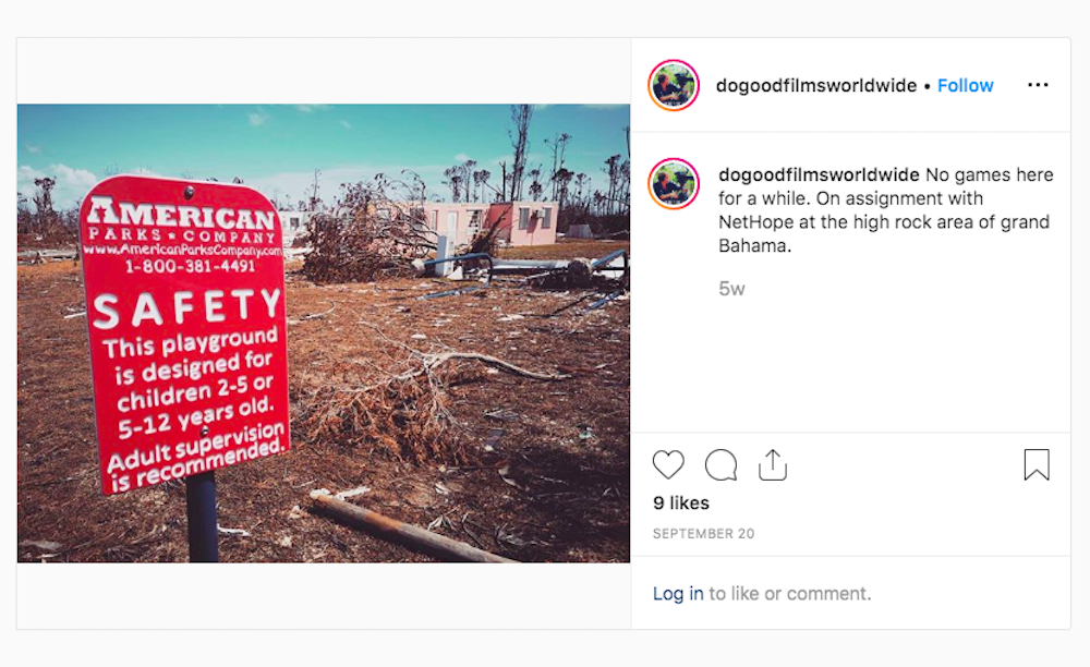 Red sign reading 'Safety' surrounded by fallen trees and buildings