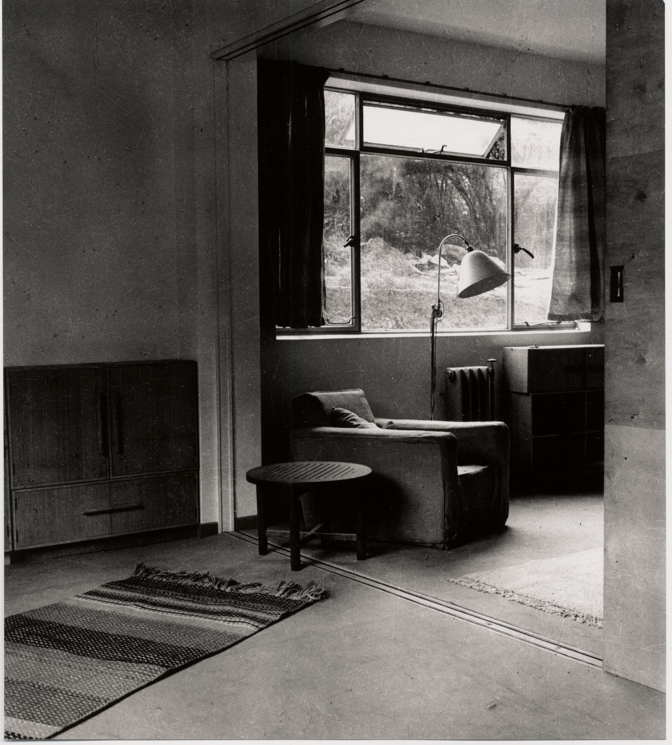 Living room space inside an Isokon Flat, featuring bespoke furniture designed with space limitations in mind