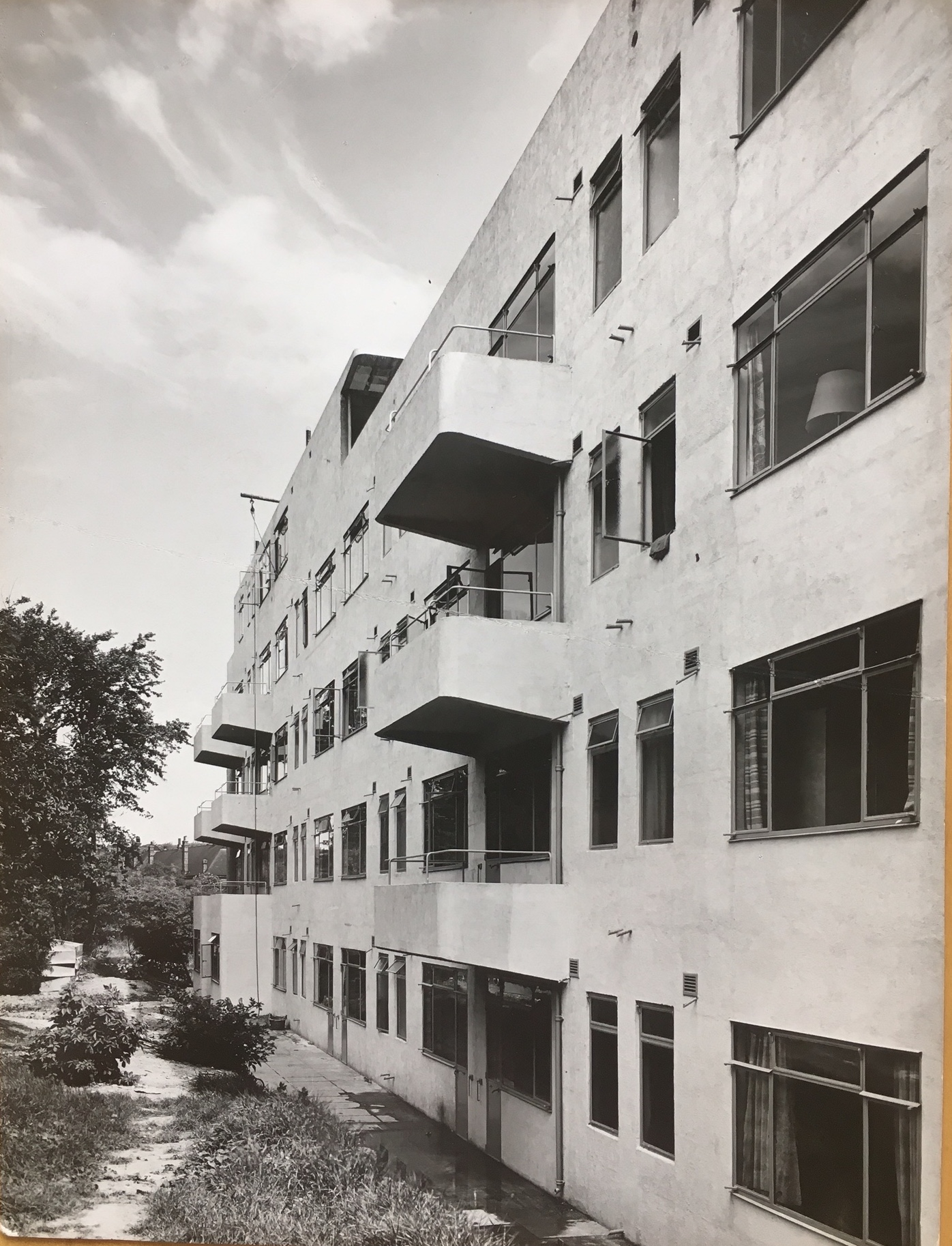 Cantilevered balconies line the rear side of the Lawn Road flats, pictured while under construction.