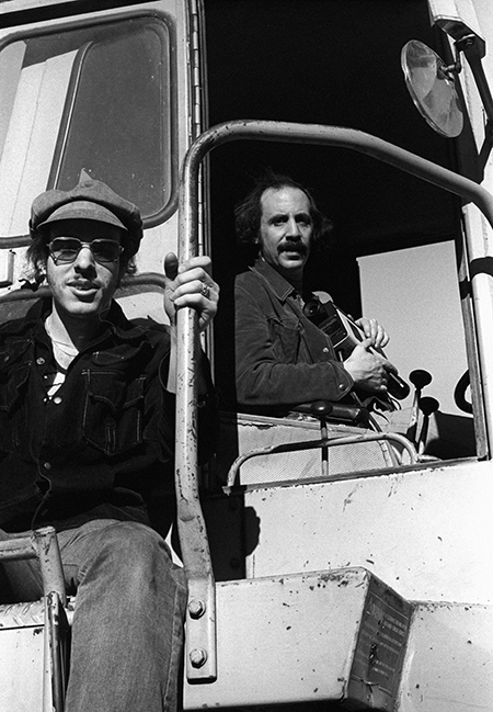 Alex Bennett sits in the cab of a steam shovel on the set of Midnight Blue.