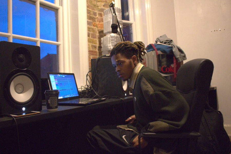 Alternative hip hop artist Danny Trash listening to music from his laptop in his Bromley South studio.