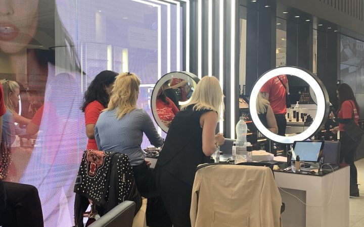 Customers getting their makeup done by professional artists at Mac