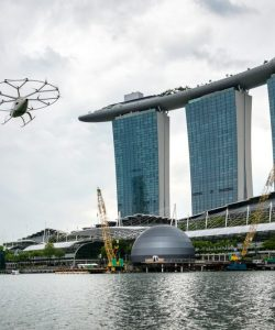 The iconic 'volocopter' making its first test flight in Singapore, against the Marina Bay Sands integrated resort.