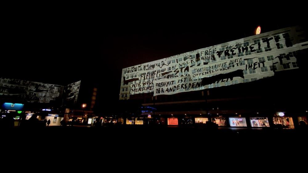 A light show illuminated a large building on Alexanderplatz