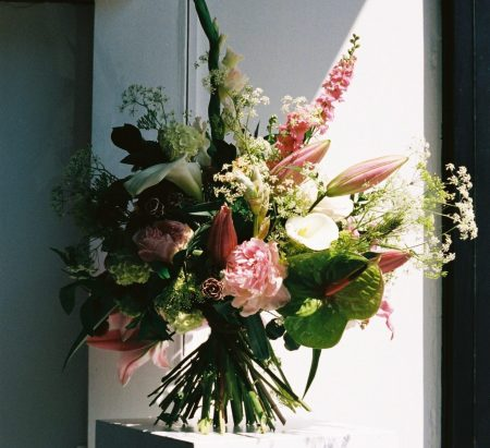 floral arrangment in the window of SAGE