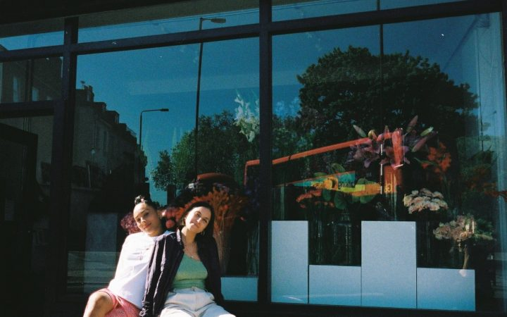 Romy and Iona sat outside their shop this summer at 232 Rye Lane