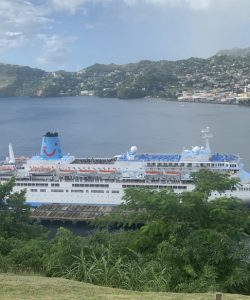 image of a cruise ship docked at a Caribbean port.
