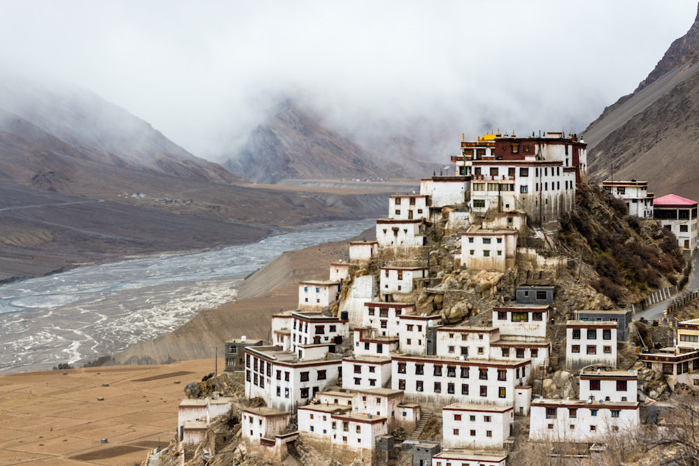 A view of a buddhist monastery in a Himalayan valley