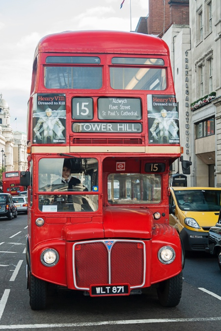 The front of a number 15 red London bus, destination Tower Hill.