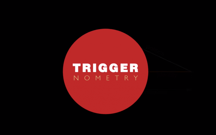 """Icon for the YouTube talk-show Triggernometry. A black background with a red circle in the centre and """"trigger"""" written above """"nometry"""" inside."""