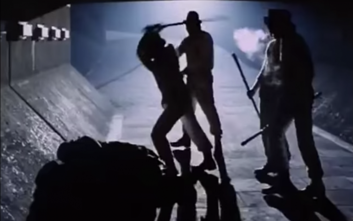 Alex's droogs attack a homeless man on the street.