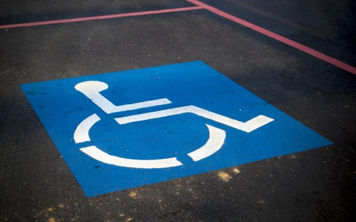 Blue disabled sign in a parking bay