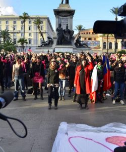 Women performing 'un violador en tu camino' while cameraman are filming them
