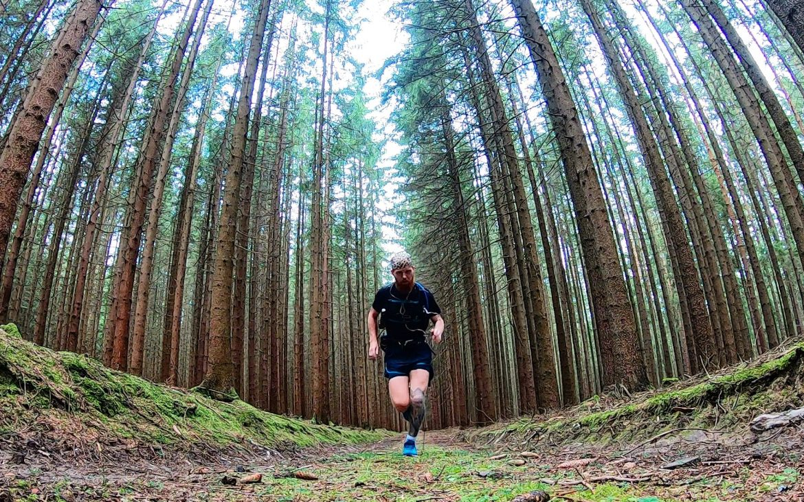 Russell running through a German forest.