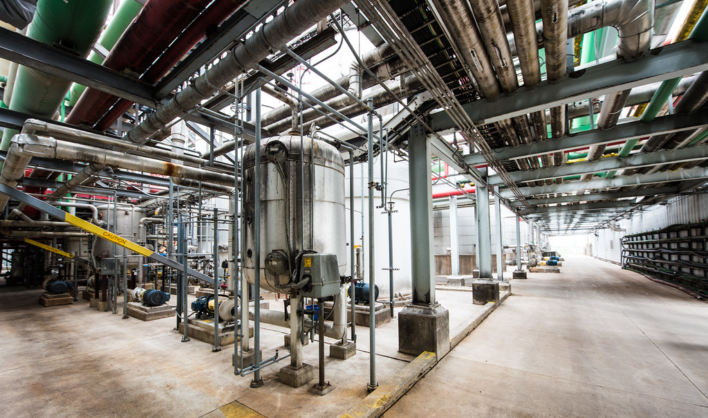 A biofuel plant filled with pipes and refinery equipment.