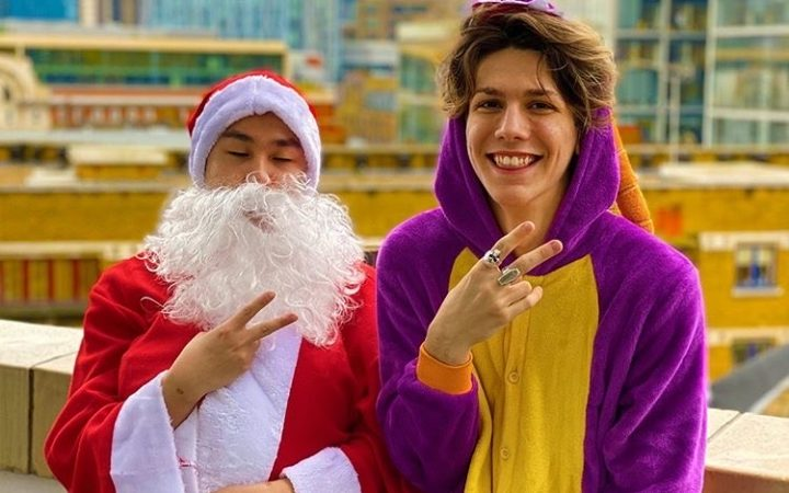A screen grab of one of Nicholai Perrett, Instagram star's videos featuring him and a friend dressed up in Santa and Dinosaur costumes