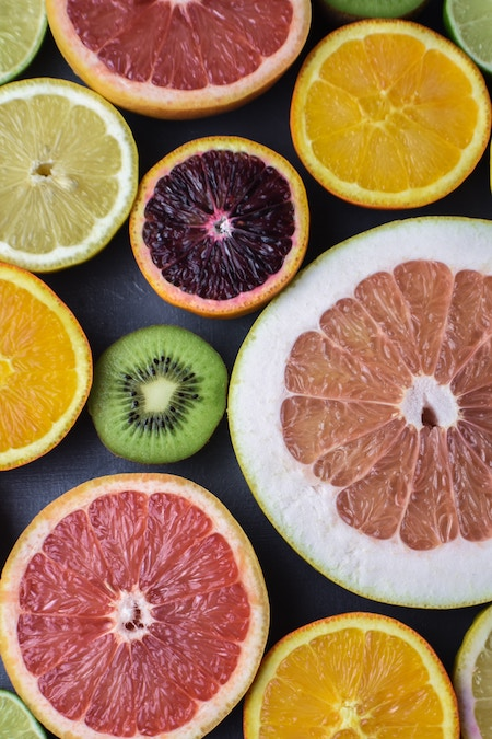 A collection of brightly coloured suit slices including grapefruit, lemon, orange and kiwi.