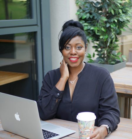 Tracy Reid enjoying being self-employed, sitting and smiling.