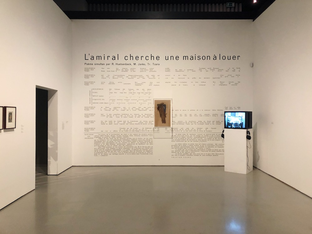 An installation featuring work relevant to the Cabaret Voltaire in Zurich, Switzerland. Featuring a French typographic display on the wall and an African-inspired mask used in performance art pieces.