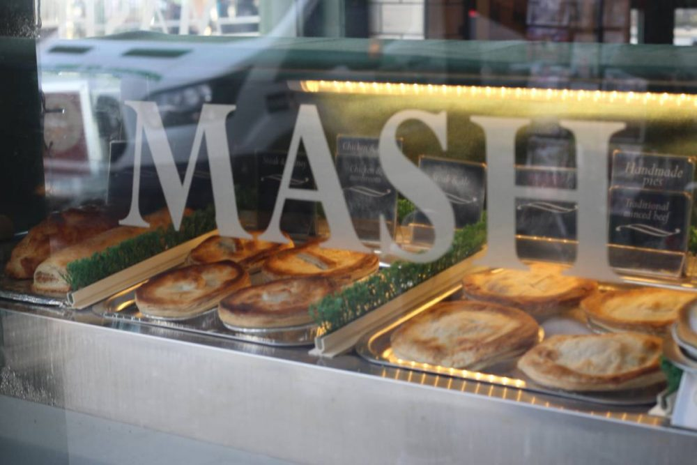 Pies lined up in the window of the shop