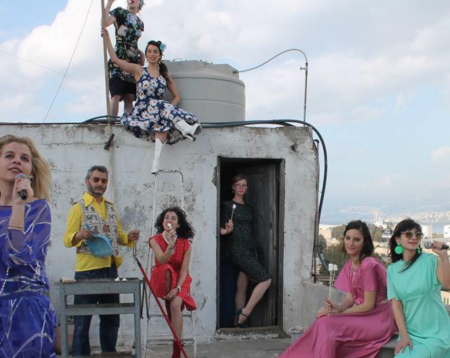 Models on roof top in Lebanon wearing clothes from Depot Vente