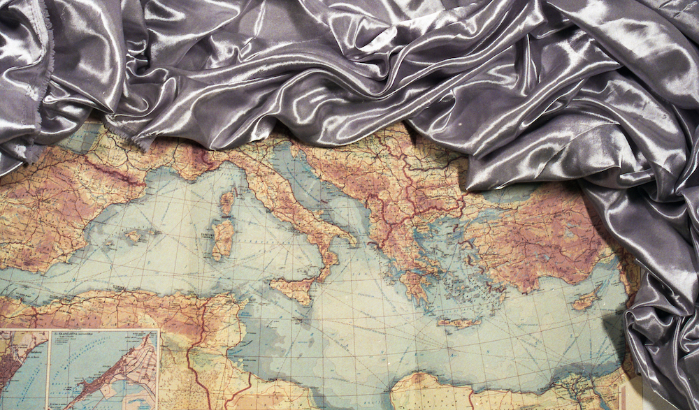 Image of map and silver, shiny fabric