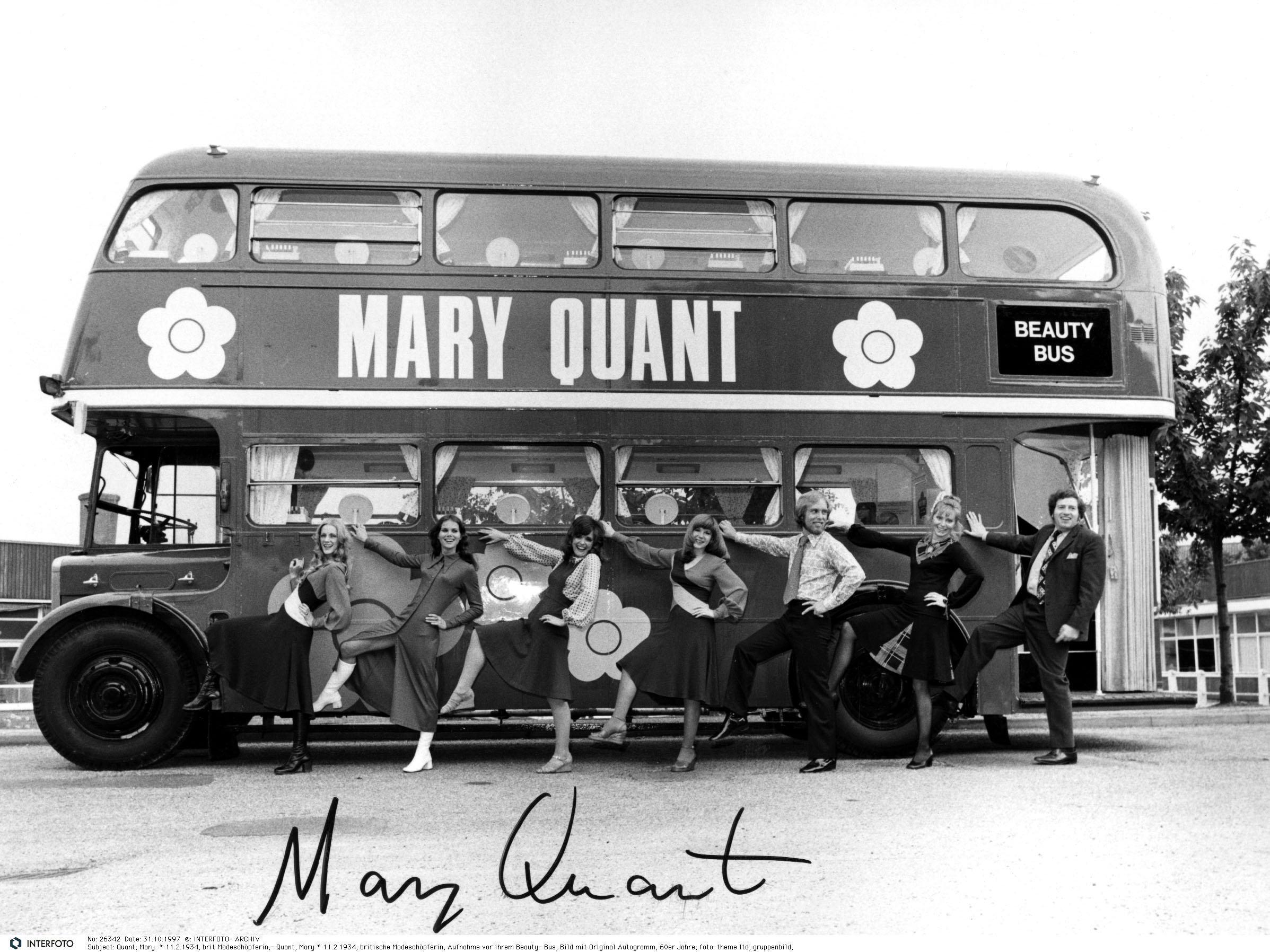Women posing in front of the Mary Quant beauty bus