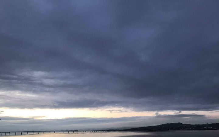 view of the two bridges to Dundee outside of the restaurant. It is now dark and moody, just before the evening comes