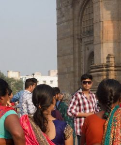 group of people standing infront of The Gateway of India monument in Mumbai