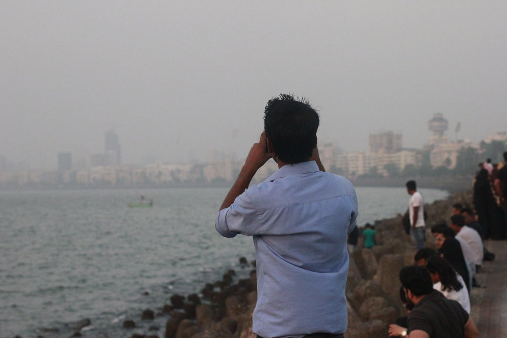 man taking a picture of the promenade in Mumbai