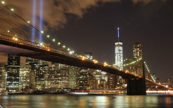 Image of 9-11 memorial lights beaming through the night sky in New York City