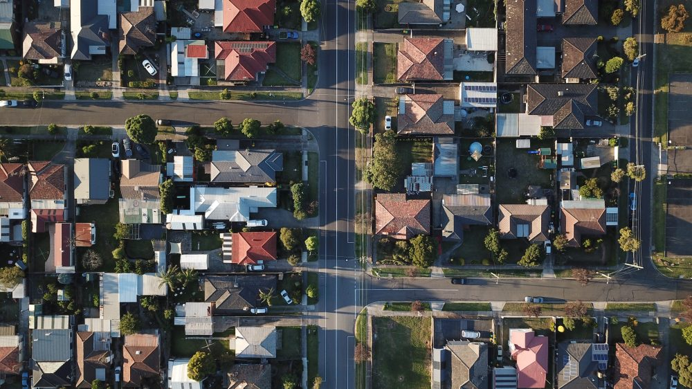Birds-eye view of houses in the summer.