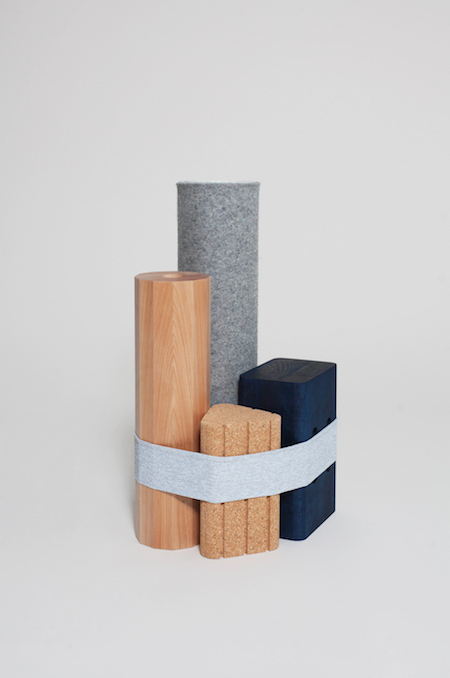 Visibility's 'Shapes Bundle', a collection of minimalist yoga accessories. A mat and three blocks are held together by a resistance band.