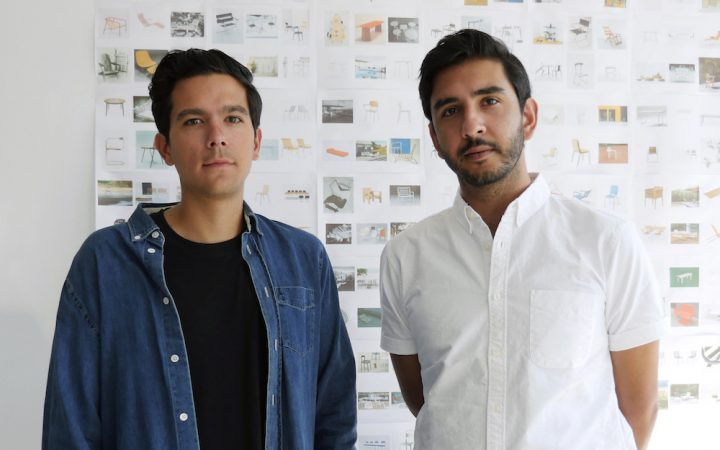 Joseph Guerra and Sina Sohrab, Visibility's founders, pictured in front of a selection of printed design and furniture reference materials