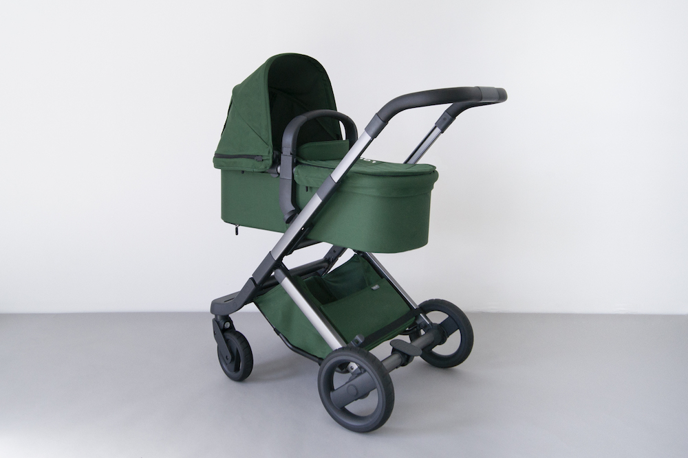 Visibility's 'The Daily' pram. A minimalist design with versatile removable parts is accented with green soft-goods