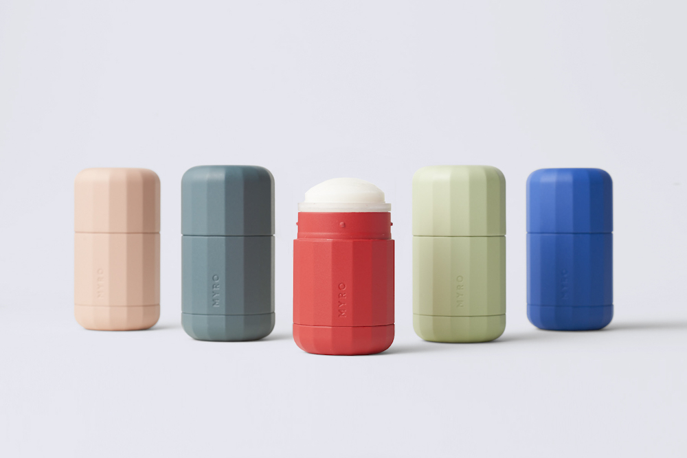 Five Myro deodorants, showcasing the range of colours available; pink, grey, orange, light green and blue.