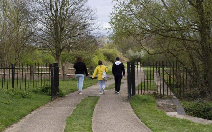 Three people out on their daily walk who did not follow social distancing rules