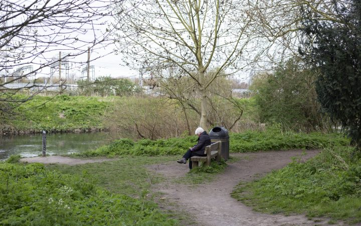 Woman sitting by herself in the park