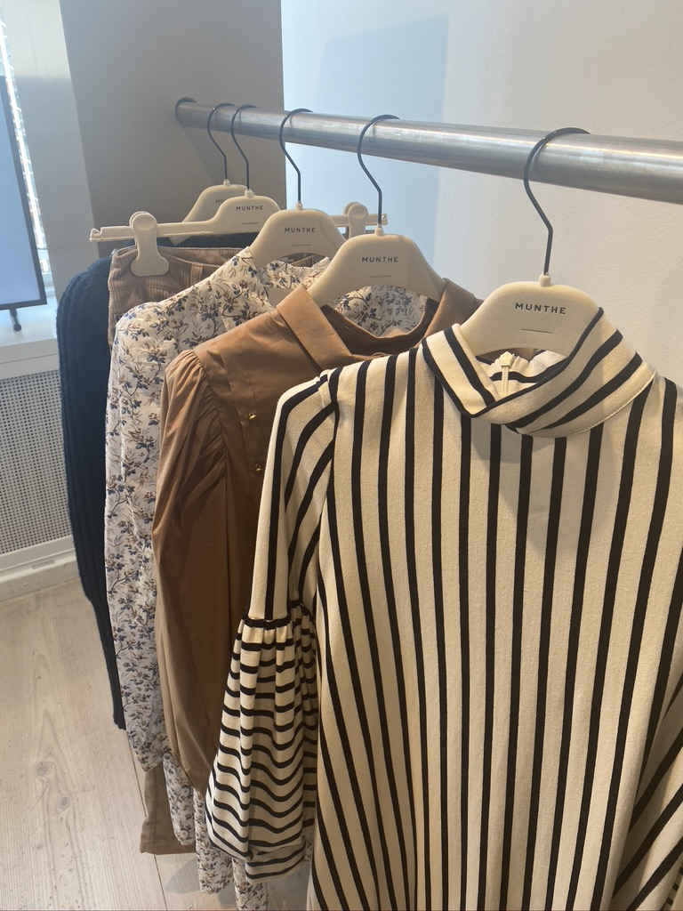 A rail displaying some of Munthe's SS21 collection in their showroom in Copenhagen
