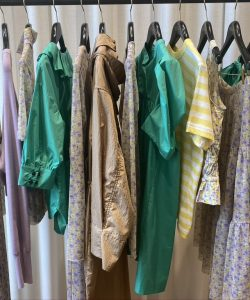 A clothing rail in Baum und Pferdgarten's showroom, displaying clothes from the SS21 collection.
