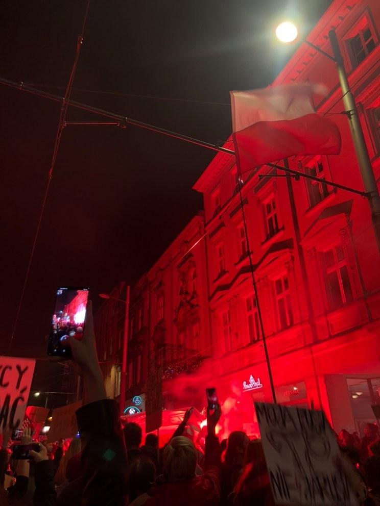 Red flares were used by the protesters in response to the pepper spray used by the police